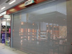 Safe View rollshutters pictured as a perforated rolling door or rolling grille for stores in a mall